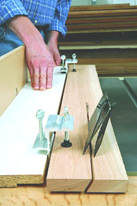 Mount clamps to table-saw guide board to create a straight reference guide to strengthen any length of lumber